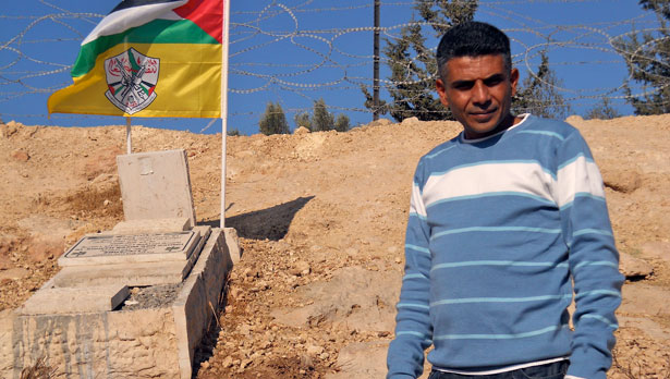Bilin leader with bassem grave