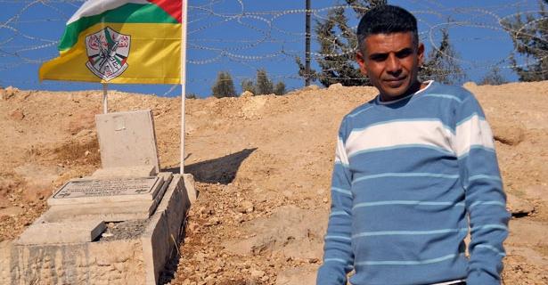 Bilin leader with bassem grave