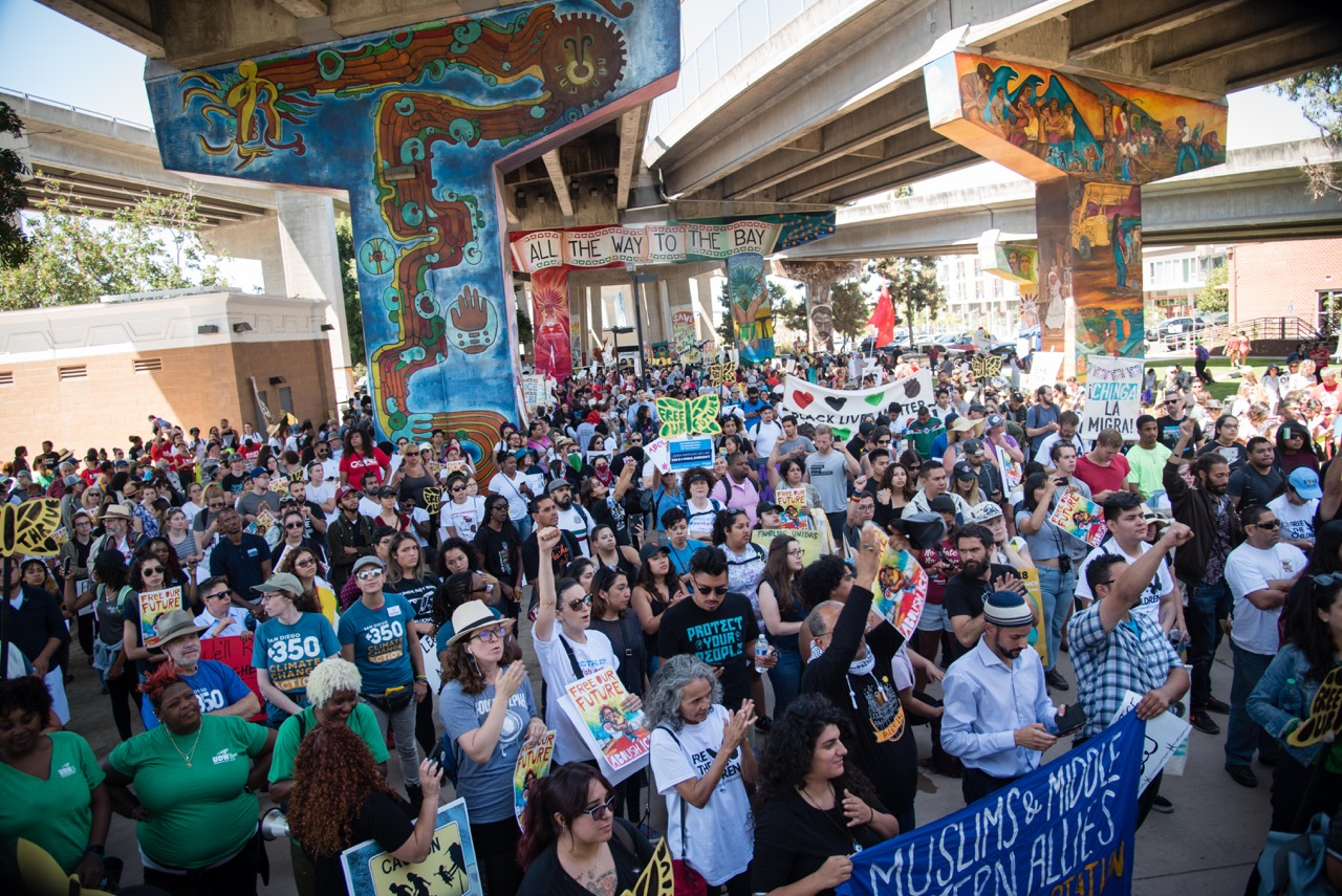 Thousands gather in Chicano Park in San Diego on July 2nd for the #FreeOurFuture rally and march organized by Mijente, The Majority, and others.
