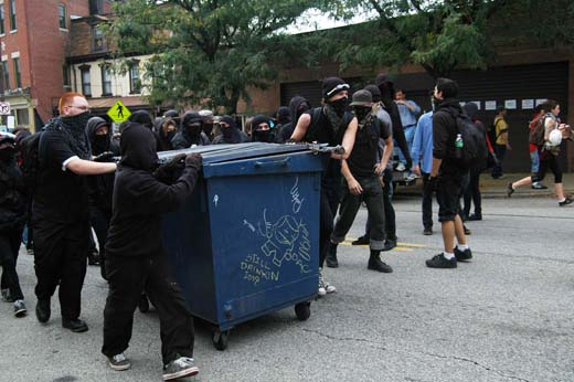 Protesters with dumpster
